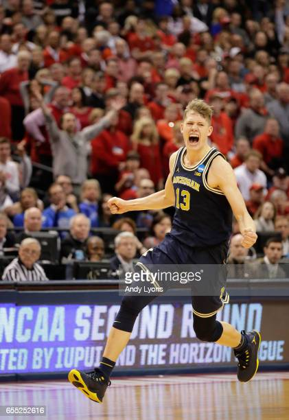 Moritz Wagner of the Michigan Wolverines celebrates their 73-69 win over the Louisville Cardinals during the second round of the 2017 NCAA Men's...
