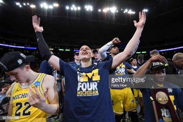 Moritz Wagner of the Michigan Wolverines celebrates with the West Regional trophy after their 5854 victory against the Florida State Seminoles in the...