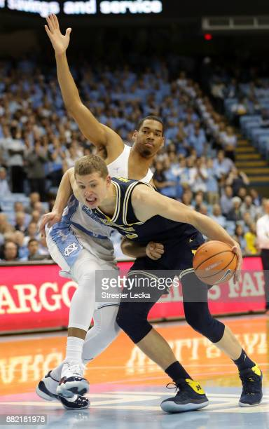 Moritz Wagner of the Michigan Wolverines drives to the basket against Garrison Brooks of the North Carolina Tar Heels during their game at Dean Smith...
