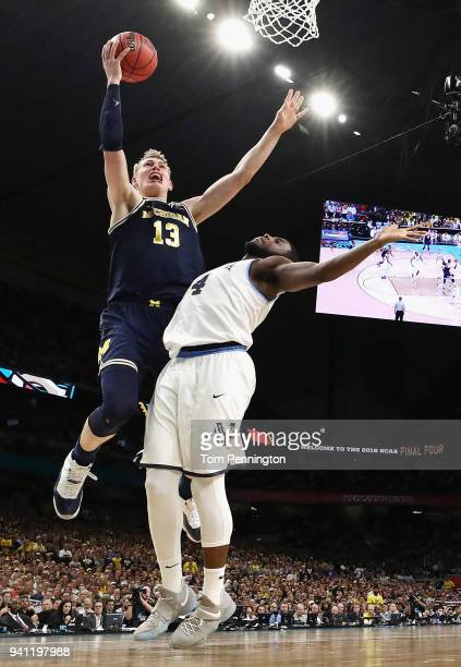 Moritz Wagner of the Michigan Wolverines drives to the basket against Eric Paschall of the Villanova Wildcats in the second half during the 2018 NCAA...