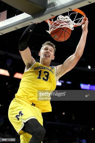 Moritz Wagner of the Michigan Wolverines dunks the ball in the second half while taking on the Texas AM Aggies in the 2018 NCAA Men's Basketball...