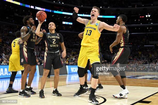 Moritz Wagner of the Michigan Wolverines reacts after making a basket and getting fouled in the second half while taking on the Florida State...