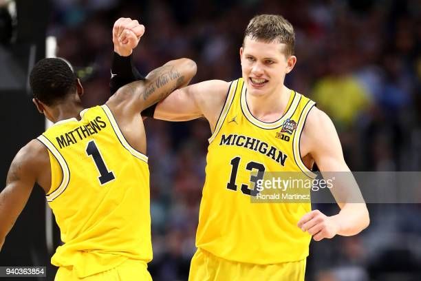 Moritz Wagner of the Michigan Wolverines reacts with Charles Matthews in the second half against the Loyola Ramblers during the 2018 NCAA Men's Final...