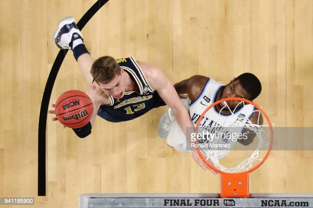 Moritz Wagner of the Michigan Wolverines shoots against Eric Paschall of the Villanova Wildcats in the first half during the 2018 NCAA Men's Final...