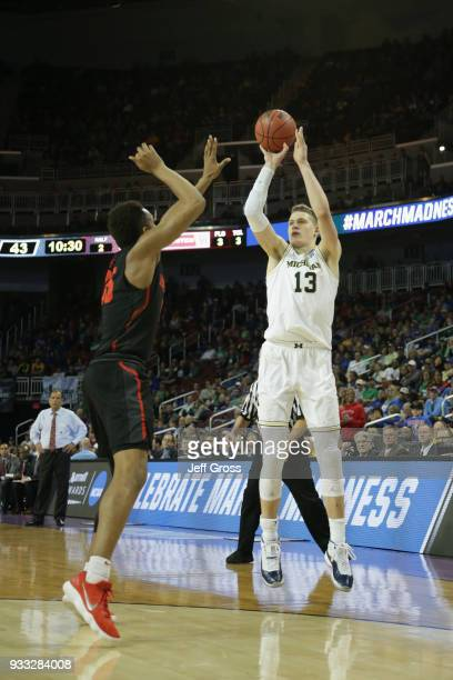 Moritz Wagner of the Michigan Wolverines shoots against the Houston Cougars in the second half during the second round of the 2018 NCAA Men's...