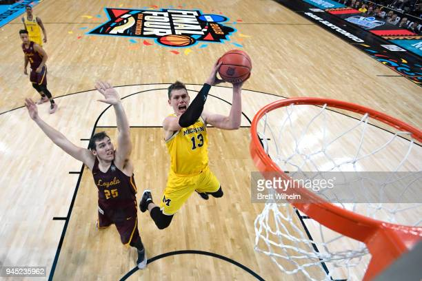 Moritz Wagner of the Michigan Wolverines shoots the ball during the first half against the Loyola Ramblers in the 2018 NCAA Photos via Getty Images...
