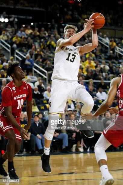 Moritz Wagner of the Michigan Wolverines takes a first half shot next to Nigel Hayes of the Wisconsin Badgers at Crisler Center on February 16 2017...