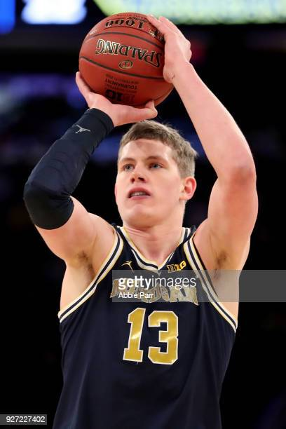 Moritz Wagner of the Michigan Wolverines takes a shot in the first half against the Purdue Boilermakers during the championship game of the Big 10...