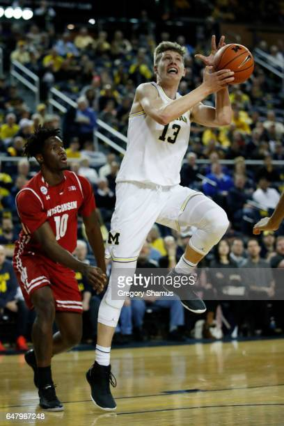 Moritz Wagner of the Michigan Wolverines takes a shot while playing the Wisconsin Badgers at Crisler Center on February 16 2017 in Ann Arbor Michigan...