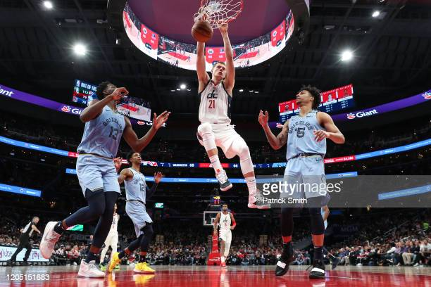 Moritz Wagner of the Washington Wizards dunks in front of Jaren Jackson Jr #13 of the Memphis Grizzlies during the second half at Capital One Arena...