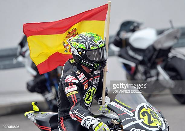 Moriwaki rider Toni Elias of Spain celebrates his victory with his national flag on the racetrack of the Moto2 race of the Moto Grand Prix of Germany...