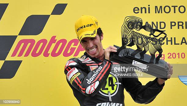Moriwaki rider Toni Elias of Spain celebrates holds up his trophy on the podium after his victory of the Moto2 race of the Moto Grand Prix of Germany...