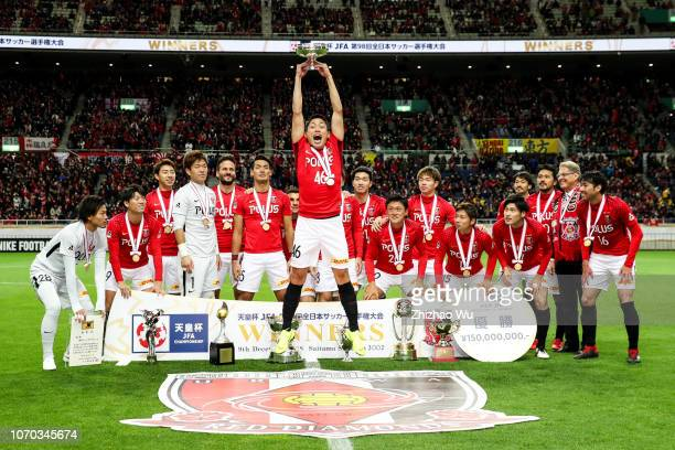 Moriwaki Ryota of the Urawa Red Diamonds leads the players of Urawa Red Diamonds as they celebrate becoming champions after the 98th Emperor's Cup...