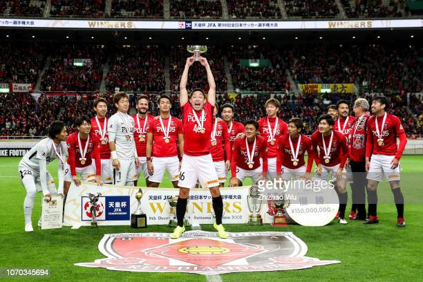 Moriwaki Ryota of Urawa Red Diamonds leads the players of Urawa Red Diamonds as they celebrate becoming champions after the 98th Emperor's Cup Final...