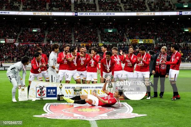 Moriwaki Ryota of Urawa Red Diamonds leads the players of Urawa Red Diamonds celebrate the champion after the 98th Emperor's Cup Final between Urawa...