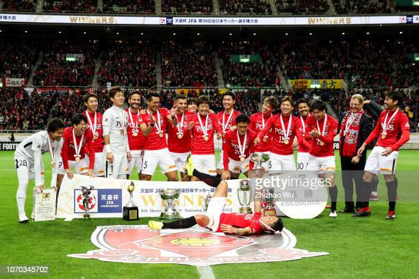 Moriwaki Ryota of Urawa Red Diamondsleads the players of Urawa Red Diamonds as they celebrate becoming champions after the 98th Emperor's Cup Final...