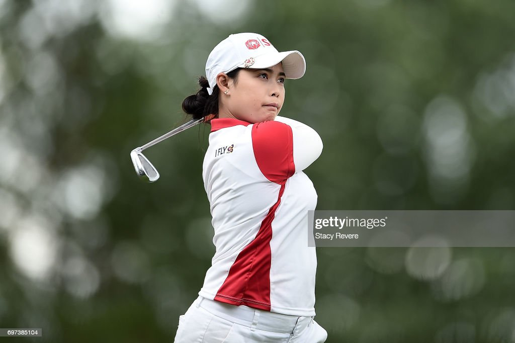 Moriya Jutanugarn of Thailand hits her tee shot on the 12th hole during the final round of the Meijer LPGA Classic at Blythefield Country Club on June 18, 2017 in Grand Rapids, Michigan.