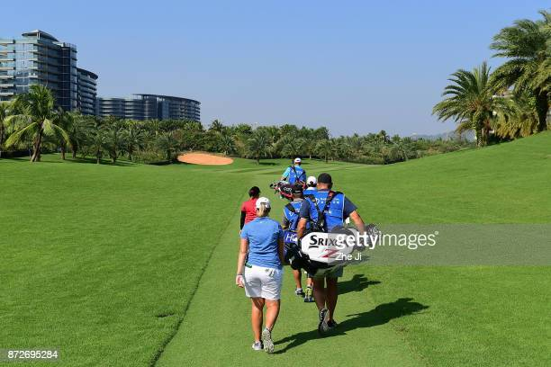 Moriya Jutanugarn of ThailandShanshan Feng of China and Ashleigh Buhai of South Africa play a shot on the 1st hole during the final round of the Blue...