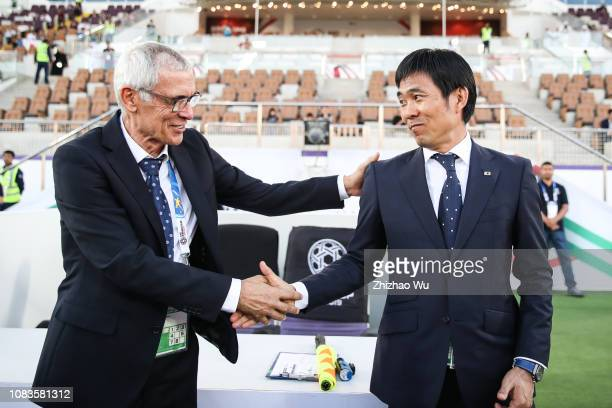 Moriyasu Hajime coach of Japan shakes hand with Hector Cuper coach of Uzbekistan during the AFC Asian Cup Group F match between Japan and Uzbekistsn...