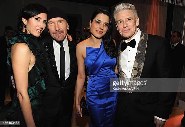 Morleigh Steinberg The Edge Mariana Teixeira de Carvalho and Adam Clayton attend the 2014 Vanity Fair Oscar Party Hosted By Graydon Carter on March 2...