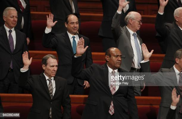 Mormon Church leaders raise their hands to sustain President Russell M Nelson as the 17th President of the Mormon Church during the first session of...