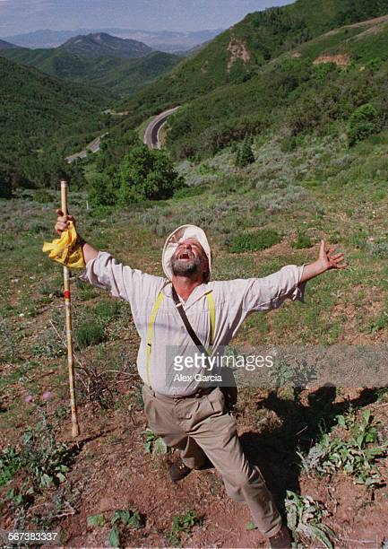 LSmormoncane guy0721AG––Reed Martin of Utah lets out bellowing sounds of joy as he reaches Big Mountain the point on the Mormon Trail where one is...