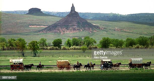 LSmormonchimney0604AAG––The Mormon Trail Wagon Train passes by the Chimney Rock natural formation on the path between Bridgeport and Bayard in...