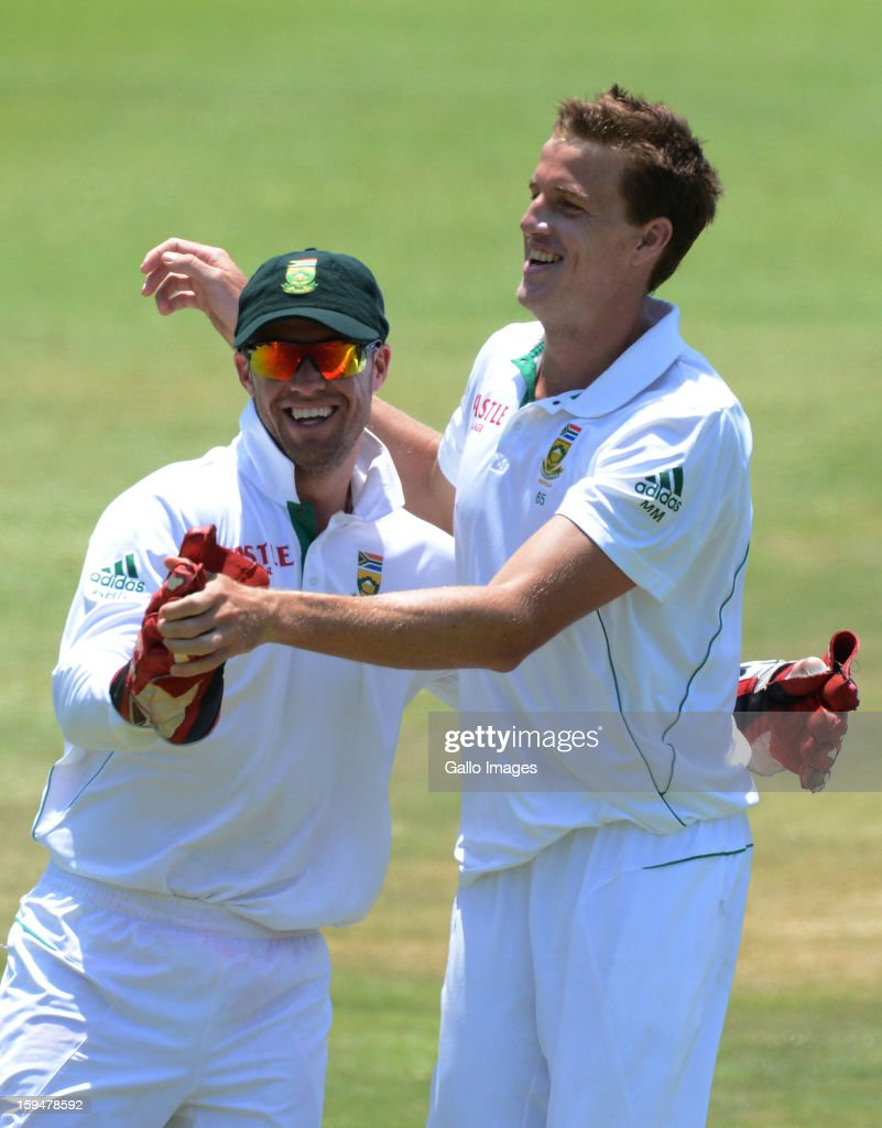 Morne Morkel and AB de Villiers of South Africa celebrate the wicket of Trent Boult of New Zealand during day 4 of the 2nd Test match between South Africa and New Zealand at Axxess St Georges on January 14, 2013 in Port Elizabeth, South Africa.