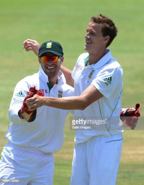 Morne Morkel and AB de Villiers of South Africa celebrate the wicket of Trent Boult of New Zealand during day 4 of the 2nd Test match between South...