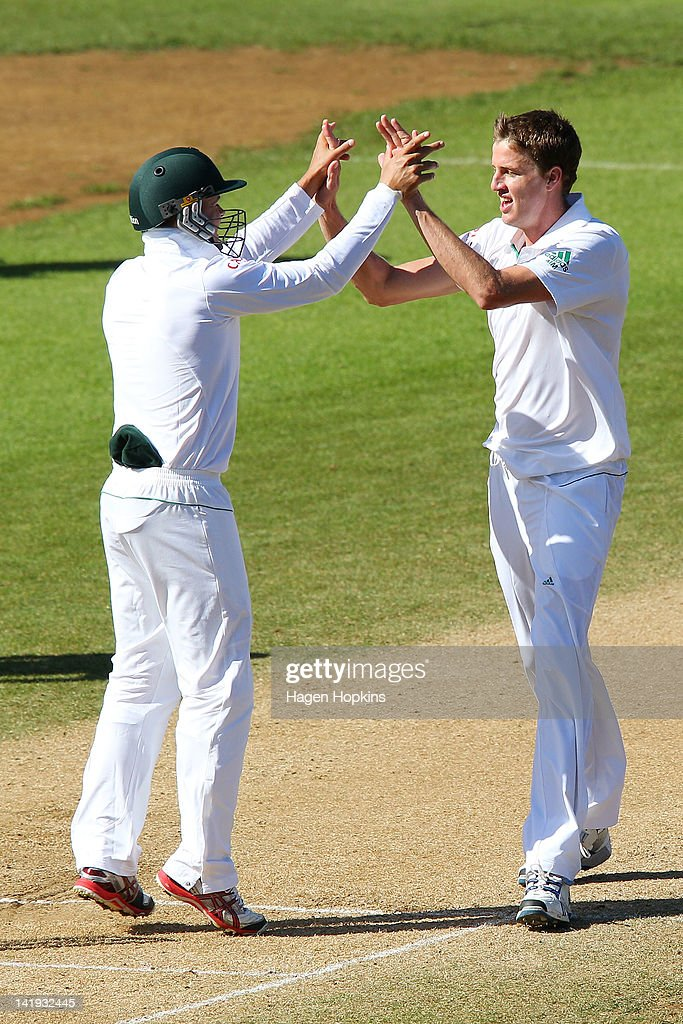 Morne Morkel (R) and Mark Boucher of South Africa celebrate the wicket of Brendon McCullum of New Zealand during day five of the Third Test match between New Zealand and South Africa at Basin Reserve on March 27, 2012 in Wellington, New Zealand.