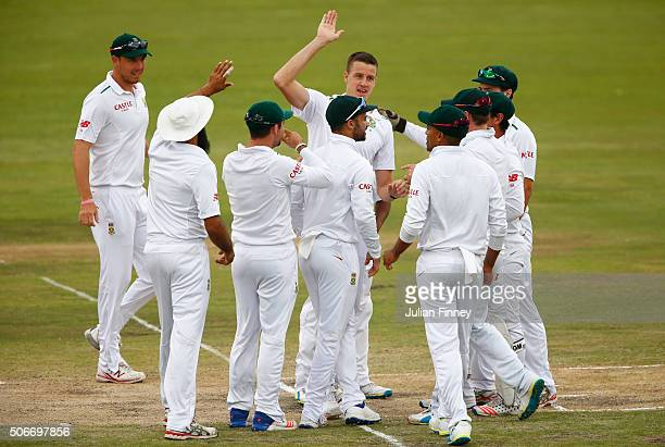 Morne Morkel of South Africa celebrates catching and bowling out Alastair Cook of England during day four of the 4th Test at Supersport Park on...