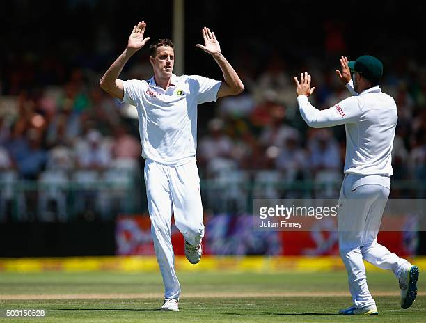 Morne Morkel of South Africa celebrates taking the wicket of Alex Hales of England after he was caught behind by AB de Villiers of South Africa...