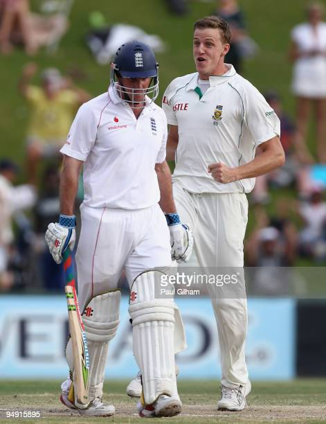 Morne Morkel of South Africa celebrates taking the wicket of Andrew Strauss of England for 1 run during day four of the first test match between...