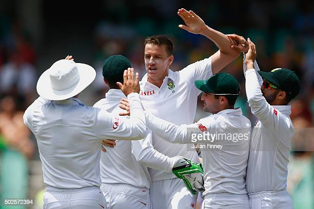 Morne Morkel of South Africa celebrates taking the wicket of Nick Compton of England during day two of the 1st Test between South Africa and England...