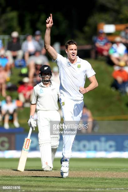 Morne Morkel of South Africa celebrates the dismissal of Jimmy Neesham of New Zealand during day three of the First Test match between New Zealand...