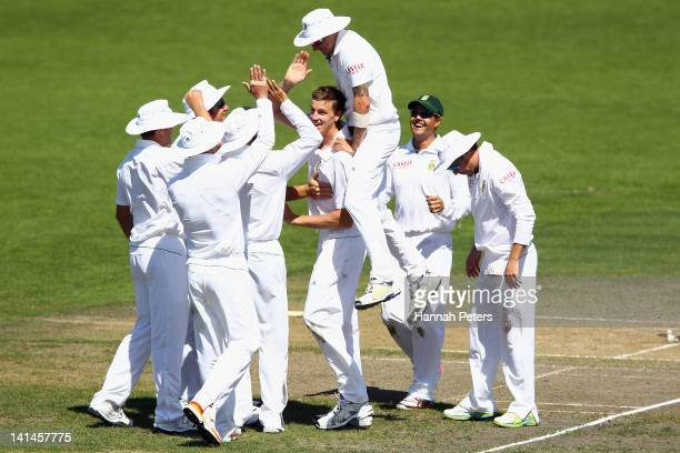 Morne Morkel of South Africa celebrates the wicket of Doug Bracewell of New Zealand during day three of the Second Test match between New Zealand and...