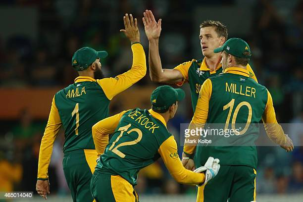 Morne Morkel of South Africa celebrates with his team mates after taking the wicket of Max Sorensen of Ireland during the 2015 ICC Cricket World Cup...