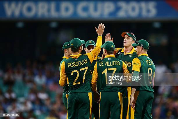 Morne Morkel of South Africa celebrates with team mates after taking the wicket of Jonathan Carter of West Indies during the 2015 ICC Cricket World...