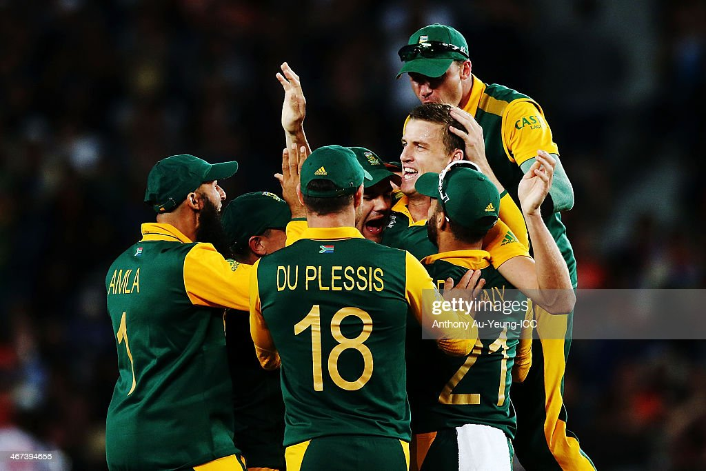 Morne Morkel of South Africa celebrates with the team after getting the wicket of Kane Williamson of New Zealand during the 2015 Cricket World Cup Semi Final match between New Zealand and South Africa at Eden Park on March 24, 2015 in Auckland, New Zealand.