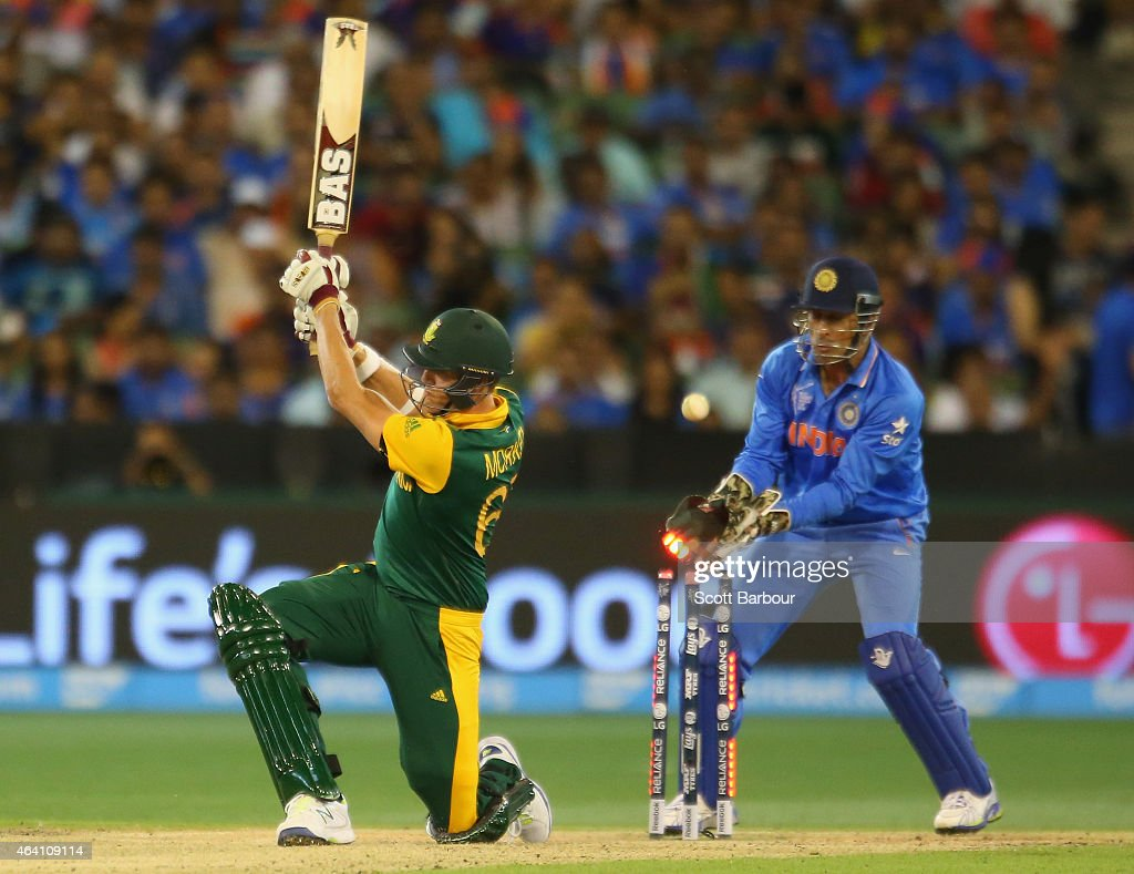 Morne Morkel of South Africa is bowled out by Ravichandran Ashwin as wicketkeeper MS Dhoni of India looks on during the 2015 ICC Cricket World Cup match between South Africa and India at Melbourne Cricket Ground on February 22, 2015 in Melbourne, Australia.