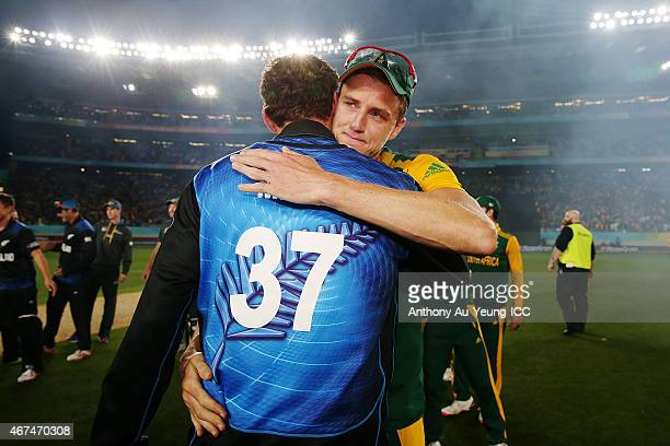 Morne Morkel of South Africa shares a hug with Kyle Mills of New Zealand after the 2015 Cricket World Cup Semi Final match between New Zealand and...