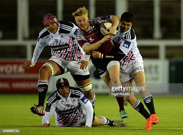 Morne Steyn of Stade Francais Paris challenges Tom Catterick of Necastle Falcons during the European Rugby Challenge Cup group G match between...
