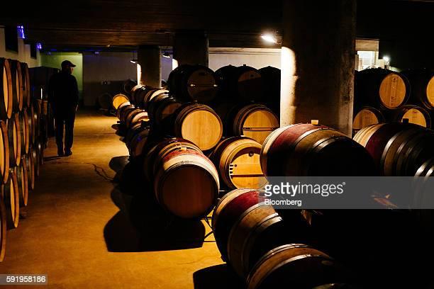 Morne Vrey a winemaker inspects Darnajou French oak wine barrels stored at the Delaire Graff Estate in Stellenbosch South Africa on Thursday Aug 18...