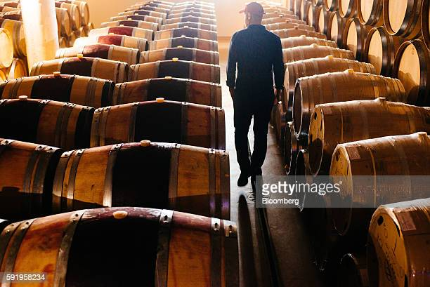 Morne Vrey a winemaker inspects Darnajou French oak wine barrels stored at the Delaire Graff Estate in Stellenbosch South Africa on Thursday Aug 18...