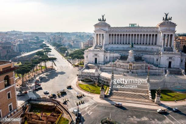 Morning aerial photo taken on March 30, 2020 shows a deserted Piazza Venezia , Via dei Fori Imperiali and the Altare della Patria - Vittorio Emanuele...