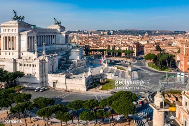 Morning aerial photo taken on March 30, 2020 shows a deserted Piazza Venezia , Via dei Fori Imperiali and the Altare della Patria - Vittorio Emanuele...
