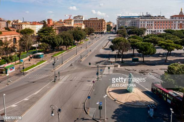 A morning aerial photo taken on March 30 2020 shows a deserted Via Enrico de Nicola and a statue of late Pope Johan Paul II near the Termini railway...