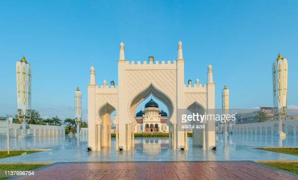 morning at baiturrahman grand mosque, aceh, indonesia - aceh stock pictures, royalty-free photos & images