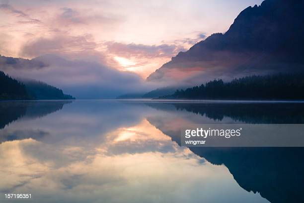 morning at lake plansee - tranquil scene stock pictures, royalty-free photos & images