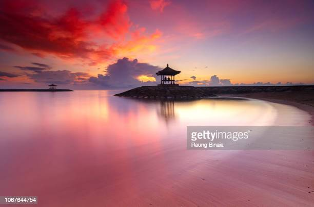 morning at sanur beach - tranquil scene stock pictures, royalty-free photos & images